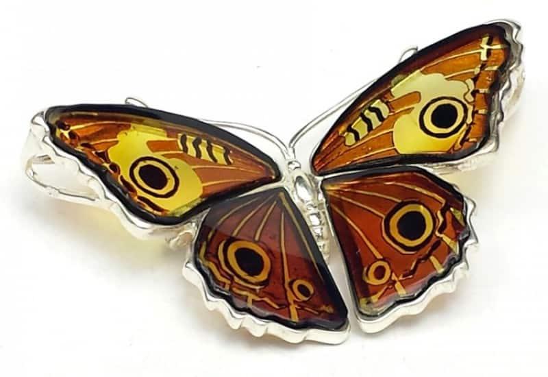 Broche y colgante de Ámbar con forma de mariposa de plata.