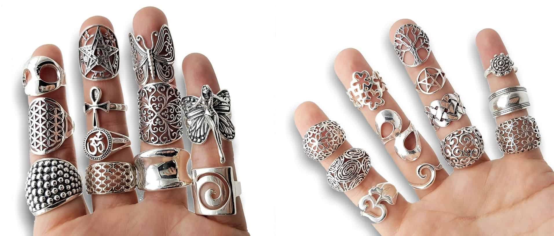 Manos llenas de anillos de plata lisa