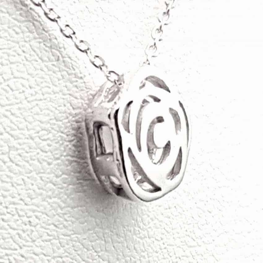 Colgante flor + gargantilla en plata.