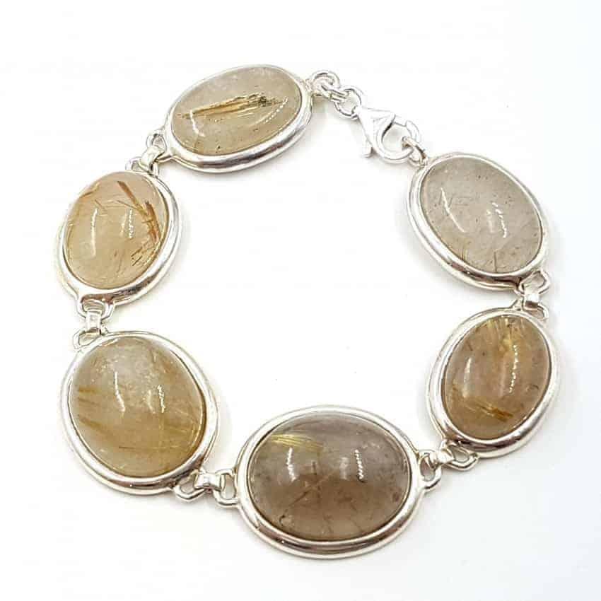 Pulsera de plata con cabujones ovalados de Cuarzo Rutilado.