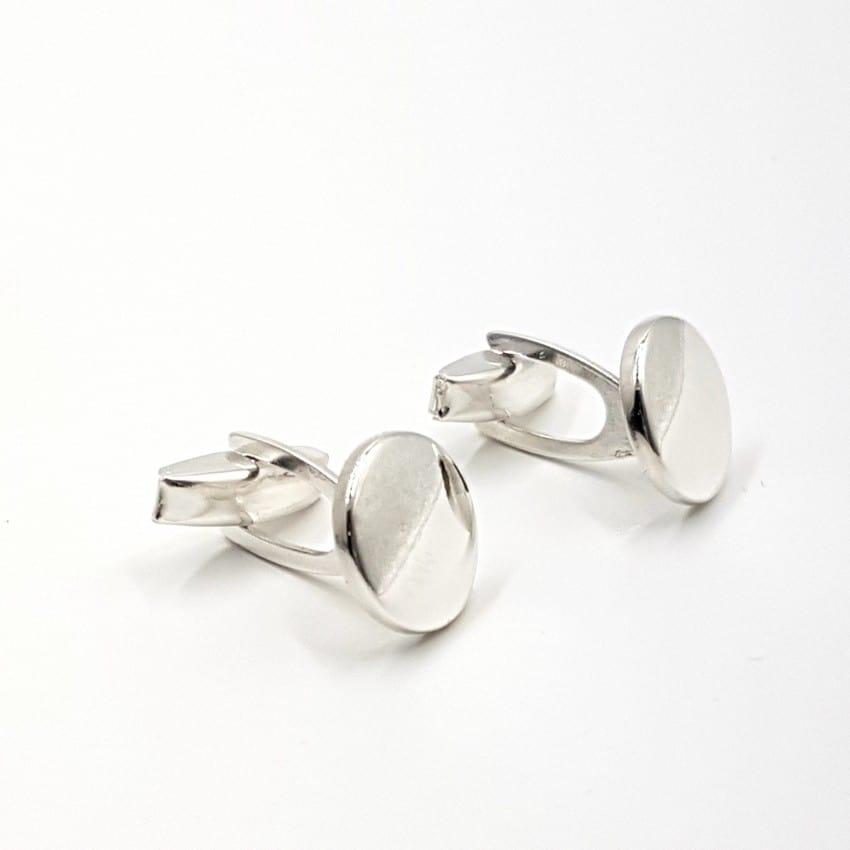Gemelos de plata con base circular