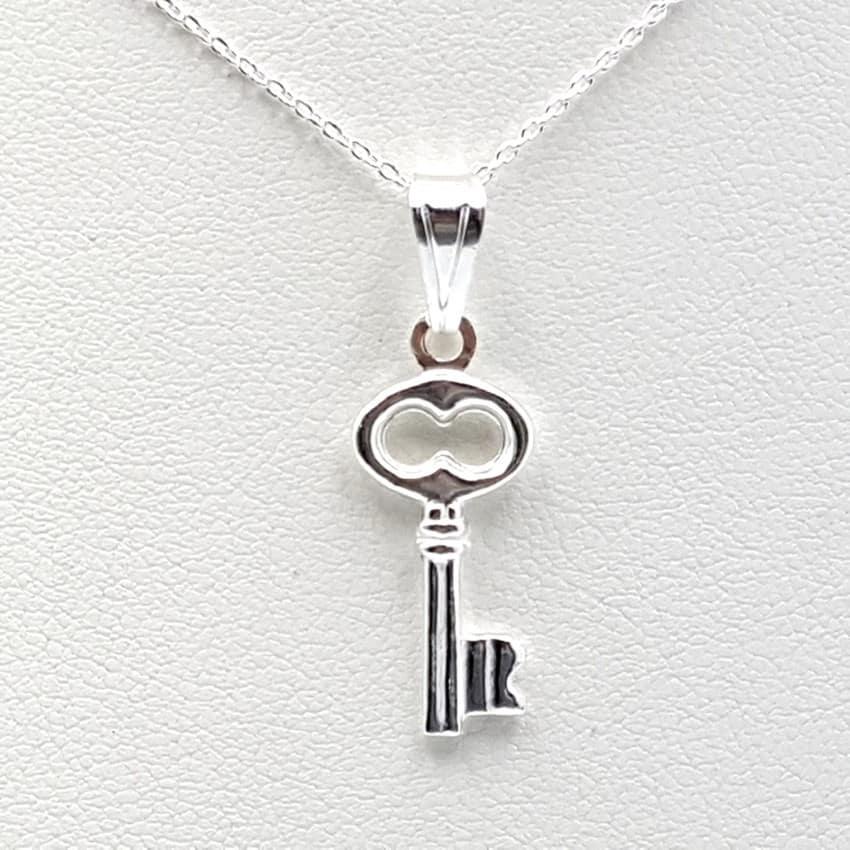 Colgante llave y gargantilla en plata