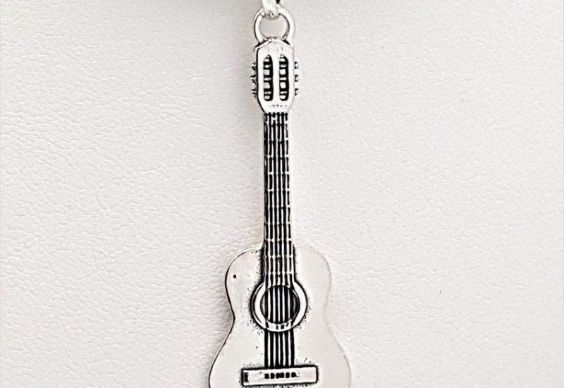 Colgante Guitarra fabricado en Plata de Ley 925 mls