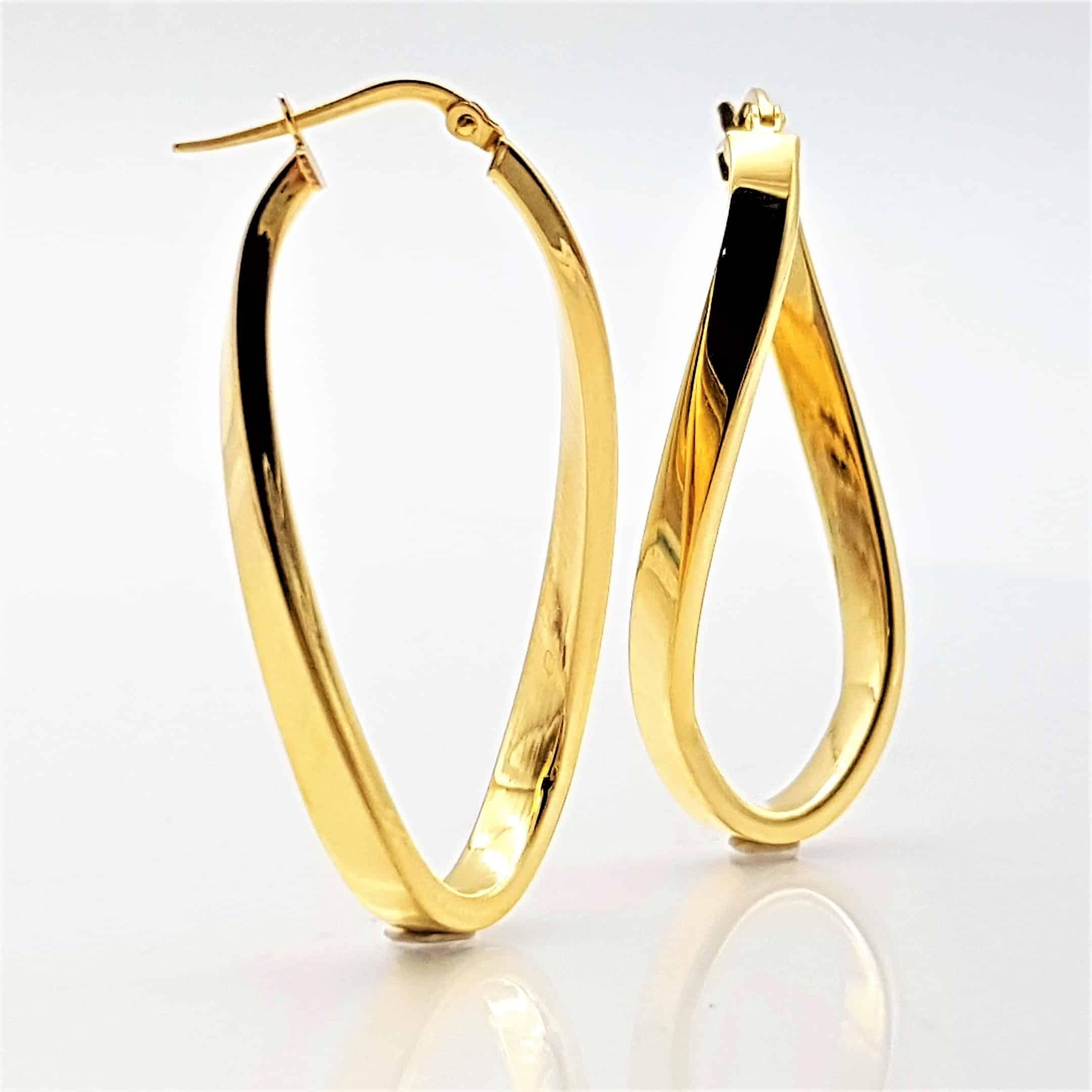 Pendientes argollas ovales curvadas chapadas en oro (7)