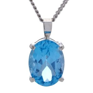 Colgante de plata con piedra de talla oval de topacio azul