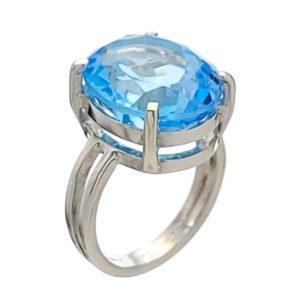 Anillo de plata con gema semipreciosa oval de topacio azul de talla 13
