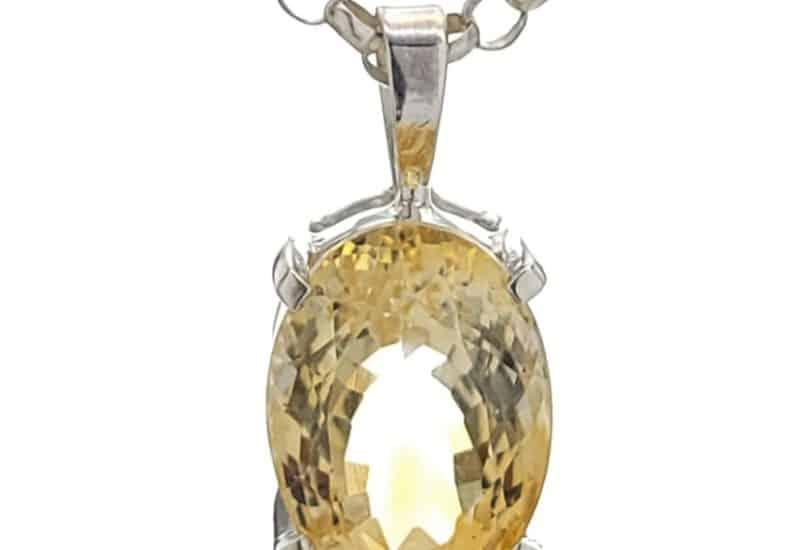 Colgante de cuarzo citrino oval tallado en plata 925
