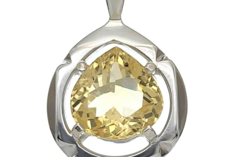 Colgante diseño lágrima con cuatro garras y piedra de citrino